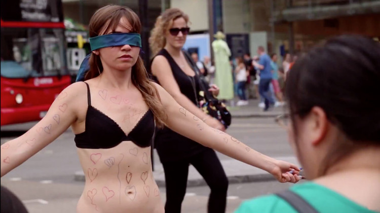 Girl-Undresses-in-Public-for-Courageous-Cause-1-750x420